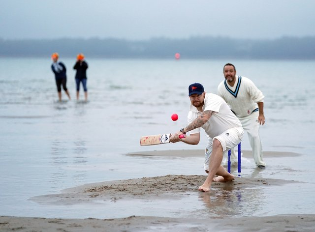Members of the Royal Southern Yacht Club and the Island Sailing Club take part in the annual Brambles cricket match between the clubs (Andrew Matthews/PA)