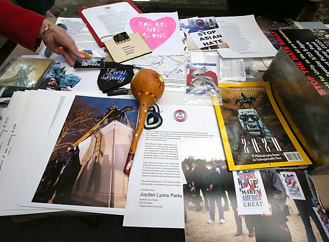 Some of the 39 items placed inside a time capsule in Richmond, Virginia. The time capsule will replace one believed to be in the base of the Robert E. Lee statue (Bob Brown/Richmond Times-Dispatch via AP)