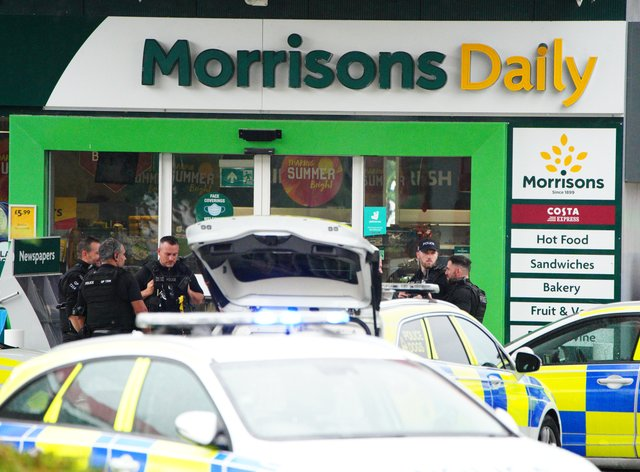 Armed police at the scene of an incident in Hengrove Way, Bristol, where a man armed with a knife is inside the shop of the petrol station. Staff members are uninjured within a safe room and in contact with officers. Picture date: Thursday September 9, 2021.
