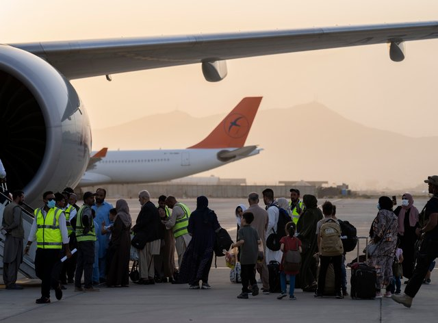 Foreigners board a Qatar Airways aircraft at the airport in Kabul, Afghanistan (AP Photo/Bernat Armangue)