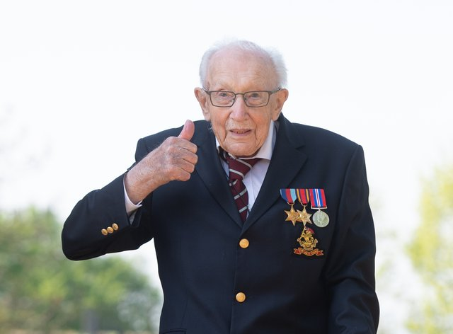 Special poppy pins made in tribute to Captain Sir Tom Moore are to be sold to raise funds for the Royal British Legion (Joe Giddens/ PA)