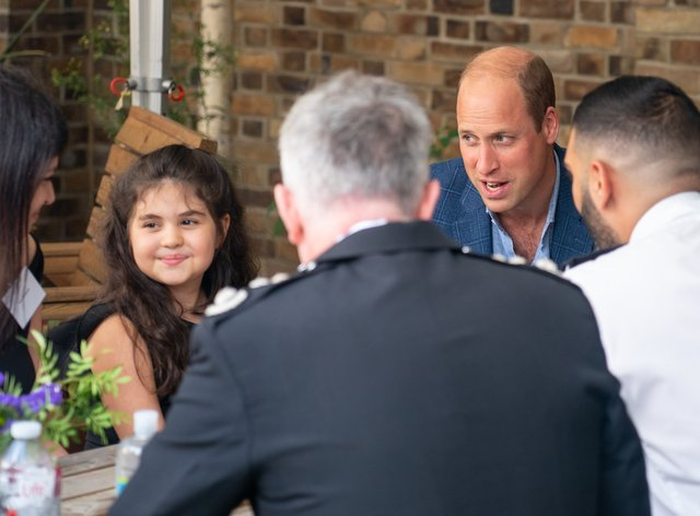 The Duke of Cambridge speaks to Noura during a visit to meet emergency responders and members of the public who received their life-saving support (Dominic Lipinski/PA)