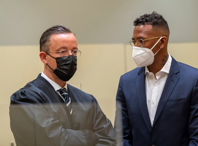 Jerome Boateng stands with his lawyer Kai Waldenat the beginning of the trial (Peter Kneffel /dpa via AP)