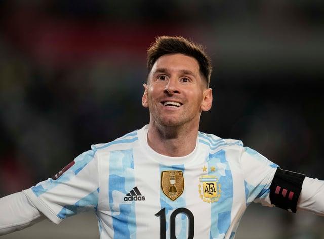 Argentina's Lionel Messi celebrates scoring his team´s third goal against Bolivia (Natacha Pisarenko/AP)