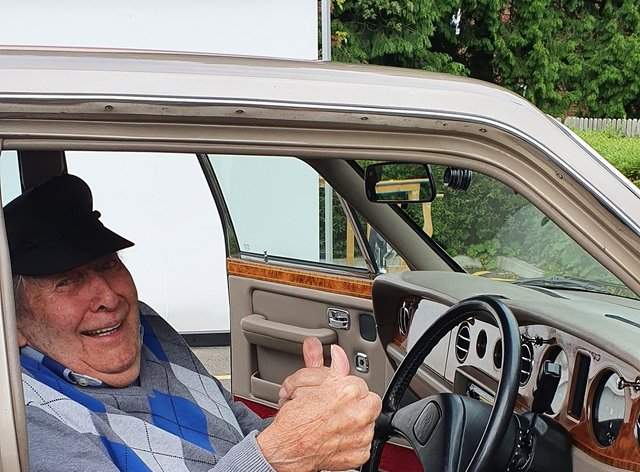 Resident Alec Goy enjoys the Rolls Royce visit at Care UK's Weald Heights (Care UK's Weald Heights/PA).