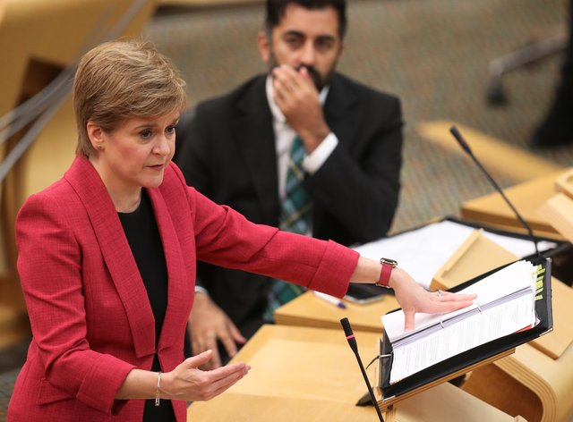 Nicola Sturgeon announced a 'significant' extension to Scotland's Covid-19 vaccination campaign, with jabs for those aged 12 to 15 and booster doses for many older Scots (Russell Cheyne/PA)