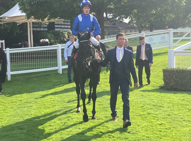 Mostahdaf returns to the winner's enclosure at Sandown (PA)