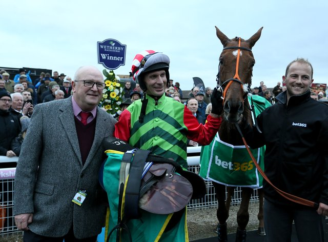 Danny Cook after winning the Charlie Hall on Definitly Red (Richard Sellers/PA)
