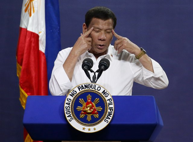 Philippine president Rodrigo Duterte has denied condoning extrajudicial killings of drug suspects (Bullit Marquez/AP)