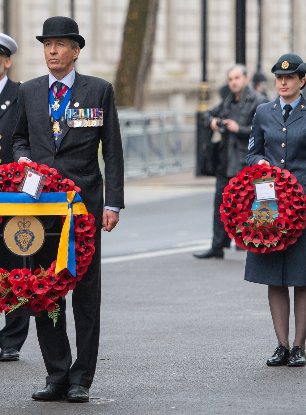 National president of the Royal British Legion Lieutenant General (Retired) James Bashall, centre, and members from the Royal Navy, the British Army, the Royal Air Force and the Merchant Navy at the Cenotaph in London (Dominic Lipinski/PA)
