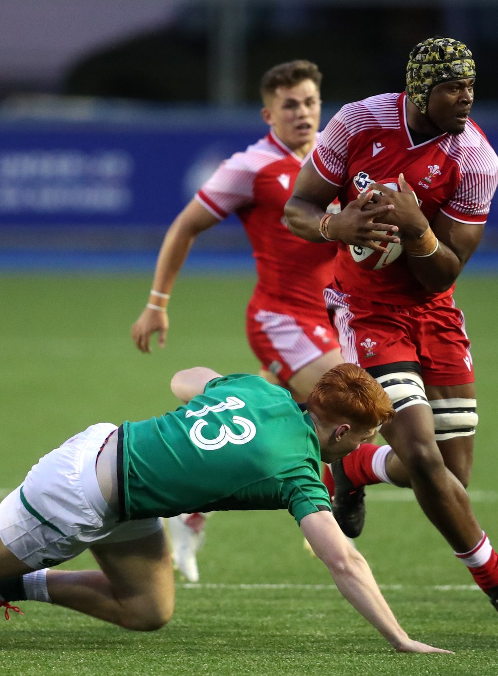 Christ Tshiunza in action for Wales Under-20s (David Davies/PA).