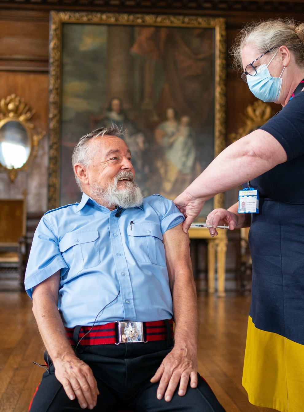 Chelsea Pensioner John Byrne receives a Covid-19 booster vaccination from deputy chief nurse Vanessa Sloane at the Royal Hospital Chelsea in London (Dominic Lipinski/PA)
